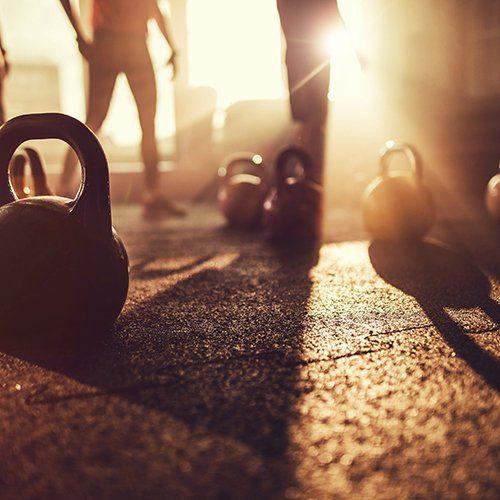 Sport equipment in gym. Kettle bell on floor background, Fitness training